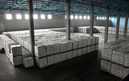 Warehouse of finished products in starch factory. Shelves with sacks in the warehouse of finished products of the plant, where potato starch is made stock photography
