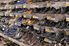 Shelves with shoes Stock Images