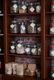 Shelves of spices. A lot of shelves full of spices in spice shop Stock Images