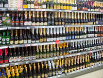 Shelves of supermarket with champagne. Royalty Free Stock Photos