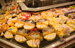 Shelves of supermarket with cheese and dairy Stock Photography