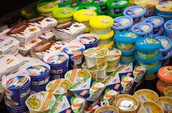 Shelves of supermarket with cheese. KALININGRAD, RUSSIA - 25 March, 2017: Shelves of supermarket with cheese Royalty Free Stock Image