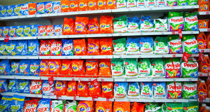Shelves of supermarket with washing powders. Royalty Free Stock Photo