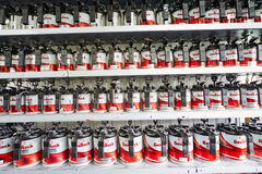 Shelves with tins of automotive paint GenRock Royalty Free Stock Photo