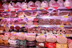 Shelves with typical Italian sausages Royalty Free Stock Photography