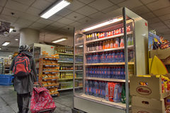 Shelves with a variety of products in the supermarket Royalty Free Stock Images
