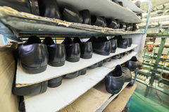 Shelves with a variety of shoes. Shoe factory Stock Photo
