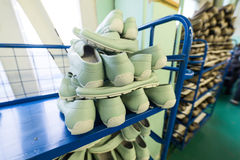 Shelves with a variety of shoes. Shoe factory Royalty Free Stock Image