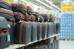 Shelves with variety of travel bags in supermarket Stock Images