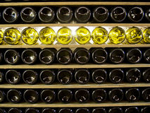 Shelves of Wine Bottles Creates Pattern. Rows of shelves stocked with wine bottles creates an interesting pattern Royalty Free Stock Photo