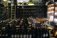 Shelves of wine bottles in a wine store Royalty Free Stock Image