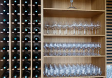 Shelves with wine bottles and wineglasses Royalty Free Stock Photo