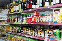 Shelves with wine, cafe and soft drinks Stock Photo