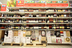 Shelves with wine inside supermarket Royalty Free Stock Images