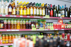 Shelves with wine and soft drinks Stock Image
