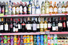 Shelves with wine, wodka and soft drinks Stock Photos