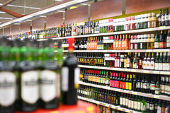 Shelves with wines in shop Stock Images