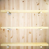 Shelves on wooden background Royalty Free Stock Photos