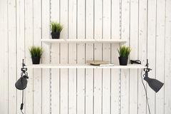 Shelves on wooden plank wall stock photography