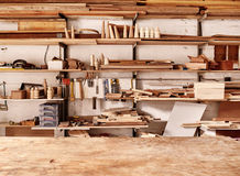 Shelves in woodwork workshop with various wooden items and tools Stock Images