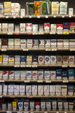 Shelving cigarettes packs. Shelves in a shop Royalty Free Stock Images