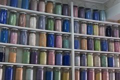 Shelving with glass jars of colorful pigments. Shelving filled with rows of glass jars of colorful pigments in a apothecary or pharmacy in Marrakech, Morocco Stock Photography