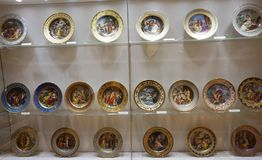 Painted porcelain plates at the Imperial Silver Collection at the Hofburg. Shelving with goldware, which was used by the Habsburg emperors in the Imperial Silver stock image