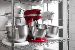 Shelving with kitchen appliances. In bakery Stock Photo