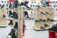 Shelving with leather shoes in a shoe store.  Royalty Free Stock Image