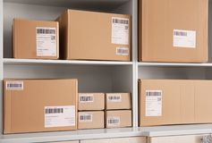 Shelving with parcels ready for shipment to customers. In home office. Startup business stock image