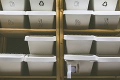 Shelving with plastic container for better storage management. Selective and low light shot Stock Images