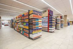 Shelving with products of different nature, variety of food displayed on the shelves. ROME, ITALY. December 05, 2018: Shelving with products of different nature stock image