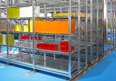 Shelving system. Metal shelving system in distribution warehouse Stock Photos