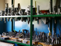 Shelving with tools in the workshop. Shelving with various tools in a mechanical workshop Stock Photography