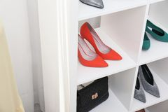 Shelving unit with shoes and purse, closeup. Element of dressing room interior stock photo