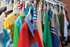 Shelving with varicoloured cloth Royalty Free Stock Photo