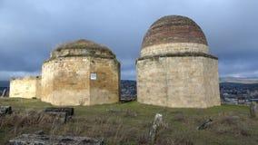 The mausoleum of the ancient complex `Eddie Gumbez`, cloudy January day. Shamakhi, Azerbaijan. SHEMAKHA, AZERBAIJAN - JANUARY 03, 2018: The mausoleum of the stock footage