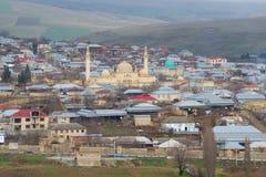 Ancient Juma mosque in the city landscape on a cloudy January day. Shemakha. Azerbaijan Republic. SHEMAKHI, AZERBAIJAN - JANUARY 03, 2018: Ancient Juma mosque in stock photo