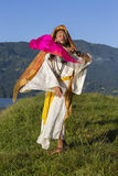 Shemale Sirena Sabiha dancing with a fan at dawn in Pokhara, Nepal.  was born in the Philippines Stock Photo
