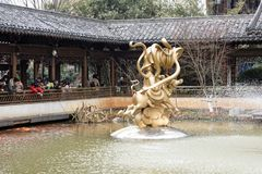 Tourist ornamental goldfish-A corner of the park. Shengjin tower brick Pavilion style tower Jiangnan typical, 50.86 meters high tower, the tower for the seven Royalty Free Stock Photo