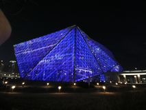 Shenyang modern theatre, glass and steel architectural design, building. Shenyang has a new modern glass steel building, illuminated at night in different colors stock photos