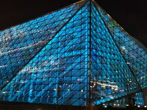 Shenyang modern theatre, glass and steel architectural design, building. Shenyang has a new modern glass steel building, illuminated at night in different colors stock image