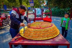 SHENZEN, CHINA - 29 JANUARY, 2017: Street vendor selling traditional arabic turron, sweet mixture of dried fruits and Royalty Free Stock Images