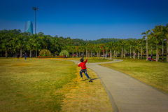 SHENZEN, CHINA - 29 JANUARY, 2017: Inside Lian Hua Shan park, large recreational area, young boy running on grass Stock Images
