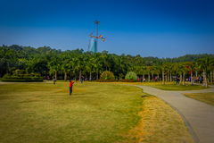 SHENZEN, CHINA - 29 JANUARY, 2017: Inside Lian Hua Shan park, large recreational area, young boy running on grass Royalty Free Stock Photography