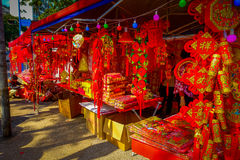SHENZEN, CHINA - 29 JANUARY, 2017: Street stores selling traditional red golden decorations, chinese tradition as part Royalty Free Stock Photo