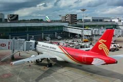 Shenzhen Airlines Airbus A320 parked at Changi Airport. SINGAPORE - DECEMBER 23: Shenzhen Airlines Airbus A320 parked at Changi Airport on December 23, 2016 in Royalty Free Stock Images