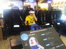 Shenzhen, China: aerospace science and technology experience activities, model space equipment. At night, shopping center, aerospace science and technology stock images