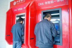 Shenzhen, china: bank atm machine. Shenzhen Baoan Xixiang CITIC Bank ATM machine, have a person is to deposit or withdraw Royalty Free Stock Photo
