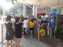 Shenzhen, China: boys and girls go to the swimming pool to buy tickets and go swimming Stock Photography